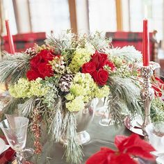 Fresh Arrangement:   To make this fresh floral centerpiece, fill a silver ice bucket with soaked florist's foam. Insert white pine branches so they arch down and touch the tabletop. Next, insert groups of fresh flowers -- we chose hydrangea and roses -- along with a few pinecones attached to sturdy wire picks for stability.
