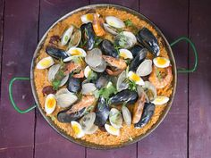Distinguished by its inclusion of sticky rice, coconut milk, and hard boiled eggs, this seafood paella is indicative of the Philippines' Spanish-influenced cuisine.