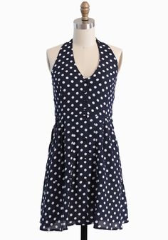"""Lovely Picnic Polka Dot Dress 34.99 at shopruche.com. Effortlessly chic, this lightweight navy dress is perfected with playful ivory polka dots, a demure halter neckline, and spacious front pockets. Completed with front button closures and an elasticized back for a comfortable fit. Partially lined.100% Polyester, Imported, 33"""" length from top of shoulders"""