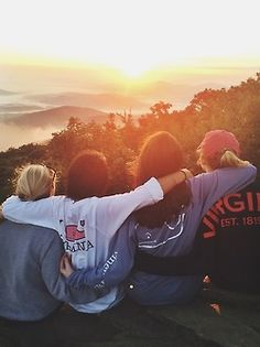 Us all stand behind the railing on the cabin's back porch ! Hook arms and turn to face the scenery further out // Gatlinburg