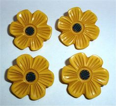 Yellow and black vintage bakelite, flower buttons