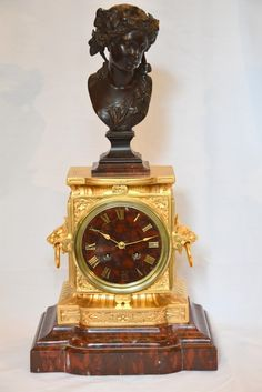 A French Bronze, Ormolu and Red Marble Mantel clock (1880 France)