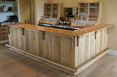 Boston Golf Club Grille Room clubhouse bar - The bar, glass racks and lower half of the server's cabinet is in quartered and figured white oak. The details are in rosewood. The upper half of the server's cabinet and wine rack is painted. Designer: Hank Gilpin