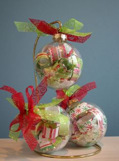 "These were inspired by a post of Trudee Sauder's blog earlier this fall. They are so adorable and easy to make that I thought I would share them with you. You need a clear 2 5/8"" Christmas ornament, sheer ribbon,..."