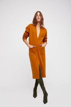 Skylar Sweater Dress | Slouchy sweater dress featured in a midi length.  * Daring plunge neckline * Front slip pockets * Slit detail on the front skirt * Stretchy fabric