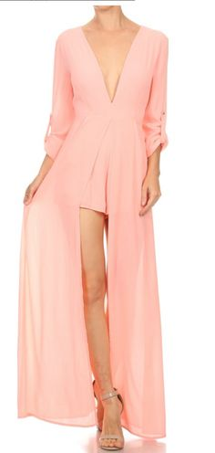 Show off your Style with this free flowing Maxi Romper. Romper features a plunging V-neckline, button tab sleeves and a maxi overlay. Partially lined. Material : Chiffon material