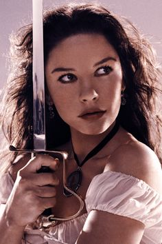 Catherine Zeta Jones. All chicks should have swords and guns.