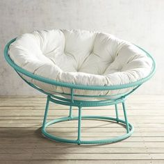 """Our iconic Papasan goes blue for a bright pop of colorful fun. Handcrafted of all-weather wicker over a wrought iron frame, it plays outdoors as well as in.<span id=""""mini-upsell"""" data-launch=""""true"""" data-required=""""false"""" data-product=""""Cushions"""" data-masters=""""PV210-2:1""""></span>"""