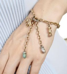 The #vintage #charm #bracelet by @turnerandtatler has tassel drops on a yellow #gold fancy link chain with an adjustable #diamond oval slide closure and 2 tassel ends : One with #turquoise and one with a #pearl suspending 3 rose and yellow gold charms : the #lion, #pig and clasped hands. #details #shop #jewelry #accessories #finejewelry #classic #style #fashion #girly #luxury