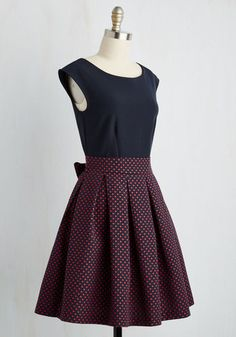 You looked lovely in Liverpool and charming in Chester clad in this navy twofer from Closet London - now it's time to take England's capital by storm! Challenging the Square Mile's street style narrative with a cardinal red dotted skirt boasting pleats and a flirty sash, this feminine number is sure to stun.