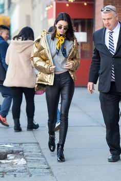 To deal with winter's current frigid temperatures, the supermodels have embraced a rather quirky trend to stand out in a sea of monochrome layers.