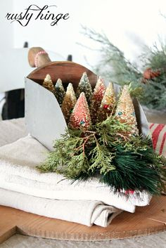 Bottle brush trees in an old grain scoop make  a great centerpiece