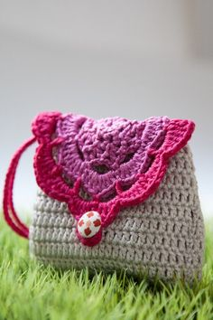 Sweet crochet wallet (coin purse) with inner lining and hand strap. $15.95, via Etsy.