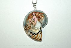"""""""Tiger Mermaid"""" Hand Painted Balinese Nautilus Mermaid Art Pendant Jewelry (2016) RESERVED  A stunning redhead mermaid with gold highlights hand painted with super fine brushes on a polished balinese nautilus shell pendant, with sterling silver trim and bail.  Inspired by the tropical Lionfish, her striped burnt orange and white tail and spotted flutes echo the tiger stripes in the nautilus shell. Pendant height approximately 6cm not including bail.  Sealed with high gloss varnish for…"""