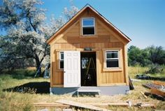 lamar alexander, off grid cabin, solar powered cabin, tiny cabin, diy cabin, tiny home, tiny house, self sufficient cabin, hand drilled wate...