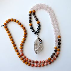 The Holistic Rain Earth Goddess Mala. Hand crafted crystal and gemstone mala beads. Healing energy jewelry.
