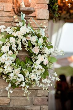 Creative flowers idea. White wedding wreath.