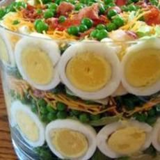 Seven Layer Salad:  (my version but I like the picture)  Chopped romaine/spinach blend, hard-boiled egg whites, frozen peas, shredded cheese, bacon bits, diced celery and ranch dressing made fresh from packet mix so it's still thin.  Optional: diced ham for more protein.