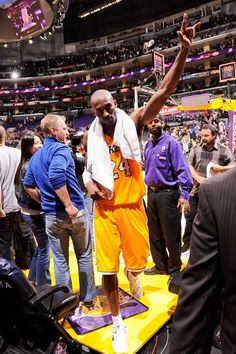 Kobe gestures to fans as he leaves the court (March 8, 2013 | Toronto Raptors @ Los Angeles Lakers | Staples Center in Los Angeles, California)