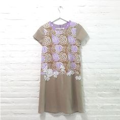 Claire 001 IDR 675.000 Front and Back Mirror View Hand Stamped Floral Batik and Brocade Combination Comfy Cut Dress Material Used : Brown Linen Fabric / Hand Stamped Batik, Cotton / Brocade Fabric Length of Dress : approx. 93 cm Standard Zipper Length (50-55cm) at the back