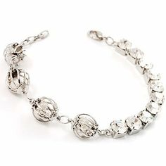 Silver Tone Crystal Kiss Bracelet Avalaya. $25.11. Metal Finish: silver. Gemstone: diamante, freshwater pearl. Material: pearls. Occasion: anniversary, bridesmaid, cocktail party, happy 18 birthday. Theme: ball