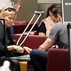 EXCLUSIVE Hugh Jackman and Deborra Lee hit the Backgammon board as they wait to depart Sydney