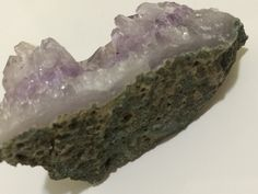 Amethyst Dreams: The Beauty's Within.  The duality and dichotomy of the rock's exterior, which is gritty and ugly, conceals lustrous beauty within.