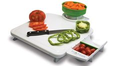Portion Control Food Prep Center. Includes scale, cutting board and adjustable measuring cup. BPA free.