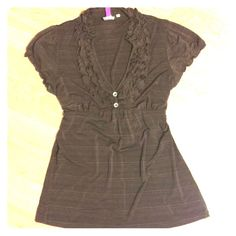 Brown Ruffled V-Neck Shirt This shirt looks nice with dress pants or skinny jeans and riding boots or brown heeled calf boots.  Besides the ruffled  detail, there are two superficial buttons to add uniqueness.  This shirt also ties in the back to adjust to the fit you like. Tops