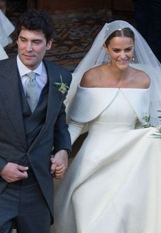 Lady Charlotte Wellesley and Colombian billionaire Alejandro Santo Domingo smile after their wedding