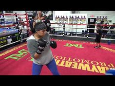 Maricela Cornejo boxing defensive drills with Dewey Cooper