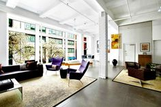 Sun-drenched Chelsea loft features massive 44-ft wall of windo...