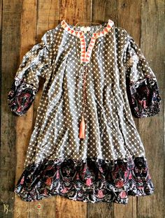 **PRE-ORDER** THIS ITEM WILL BE RESTOCKED ON 01/30/17. PRE-ORDERS WILL SHIP IMMEDIATELY UPON ARRIVAL. Gorgeous lightweight mixed-print Tunic Dress. V-neck, hi-low style with 3/4 gathered sleeves. One