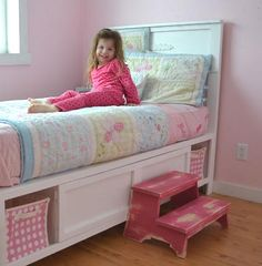 Cute for a little girl's room...love the drawers and the pink basket drawers on the sides...