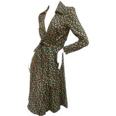 Diane von Furstenberg floral print Italian wrap dress. 1970s. This stylish wrap dress is illustrated with a field of delicate   flower blooms; ---#vintagebeginshere at www.rubylane.com @rubylanecom #fallfashion #designerfashion #dvf