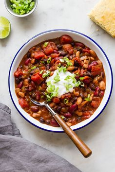 This quick and easy Three Bean Chili recipe is perfect when you want a cozy warm vegan chili in 30 minutes or less! Healthy, hearty and perfect for lunch, dinner or meal prep ideas. #veganrecipes #veganchili #healthyrecipes