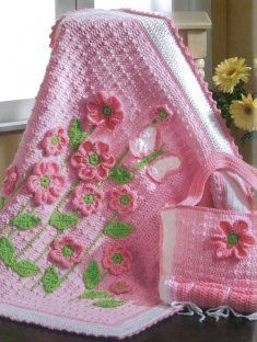 What a pretty blanket for a newborn baby girl! Instead of crochet, would be pretty with Minky for the blanket... and 3d machine embroidered flowers....