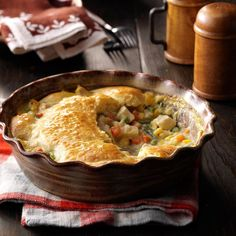 "Chicken Biscuit Potpie Recipe -""This hearty meal-in-one takes just 10 minutes to assemble before popping it in the oven,"" says Dorothy Smith of El Dorado, Arkansas. Not only is it easy to prepare, it's easy on your budget at just 54 cents a serving."
