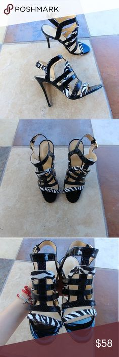 Ivanka Trump haslets sandals Brand new sandals.  Cage-style sandal, zebra-pattern and black straps. Back strap with buckle closure. Ivanka Trump Shoes Sandals