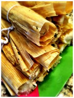 Roasted Chicken and Cilantro Tamales   (makes 10-15 tamales)       2 bone-in skin on chicken breasts  2 tbsp cumin  olive oil  salt and pepper  4 cups masa (can be purchased at any Mexican market or in Mexican section of market)  10-15 corn husks (soaked in water for 20 minutes)  1 1/2 cups queso fresco (crumbled)  2 cups fresh cilantro (chopped)  cooking twine