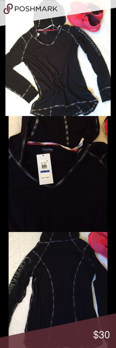 NWT Calvin Klein Performance Long Sleeve Hoodie Calvin Klein NWT $39.00 Performance  Size XL Black with Gray Lettering  60% Cotton 40% Polyester  26in Shoulder top to hem front 27in Shoulder top to hem back 21in Armpit to Armpit unstretched  25in Armpit to Armpit stretched  26in Sleeve Cuffed Sleeve that unfolds to cover hand Hooded Calvin Klein Tops Tees - Long Sleeve