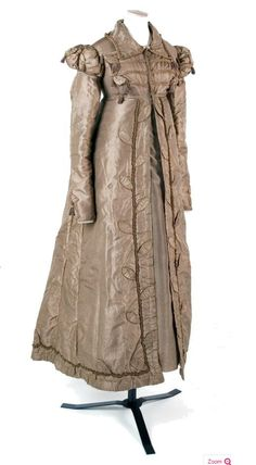 1818 - 1820 Silk Pelisse   A fawn silk carriage dress pelisse, with frogged front, Cap sleeves over long sleeves. Tasselled decorations.