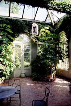 TO HAVE SUCH A BEAUTY!  I would never leave a solarium so lovely.  Skylight and brick floors perfect