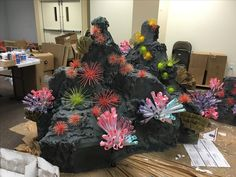 Fake rock , artificial , cardboard rock !! Made this for VBS this year- Theme is Deep Sea Discovery and i made 6 of this rocks. @ Opendoor Presbyterian Church #Coral reef rock- made out of cardboard boxes, foam spray, paint #Sea urchin-toothpick/skewer+foam ball #coral reef- paper cone