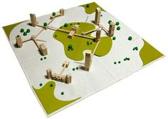 Urban Playscape. Create a wonderful mini city scene with this wood and felt fabric set. This open ended and imaginative construction and mini world set includes 100 sustainably sourced wooden pieces.