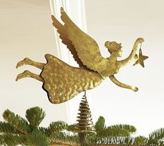 I'm looking for something different to top my tree.  Wish this had some lights.  Gold Angel Tree Topper #potterybarn