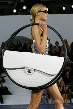Here it is again, the ultimate purse that comes standard with two hula hoops.   Chanel Spring 2013 RTW - Ethel Fashion Styling Life❤️