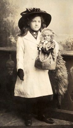 Antique photo of Edwardian girl with her doll, circa 1900. I love seeing these, and I love when our fans send us pictures with their dolls.