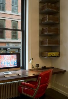 Corner office. Want to take advantage of the window and hide that radiator? Install corner shelving for storage and lay down a countertop to invent a cozy and comfortable little space for work