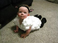 To make a sheep costume, glue cotton balls to a white Onesie and top with a black headband with floppy ears.